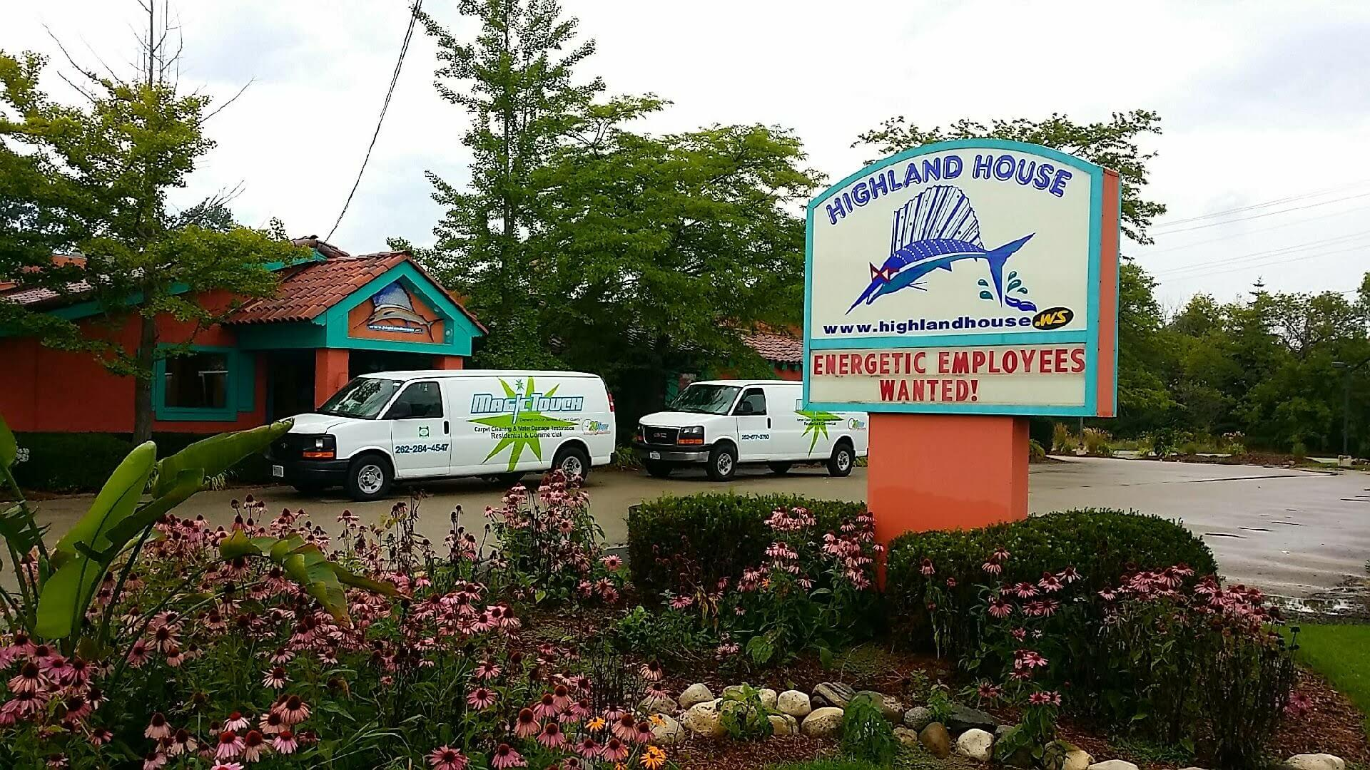 Magic Touch Carpet Cleaning and Water Damage Restoration vans parked outside of the Highland House restaurant in Mequon, WI.